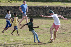 Sri Lankan boys play football with foreign men inside the old Dutch Fort at Galle in Sri Lanka.  Stock Image