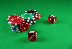 An Action shot of 5 dice thrown onto the table. Action shot of 5 dice thrown onto a table - fast shutter showing dice in the air Stock Images