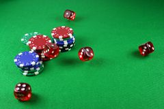An Action shot of 5 dice thrown onto the table. Action shot of 5 dice thrown onto a table - fast shutter showing dice in the air Stock Photos