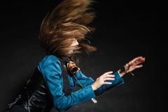 Action shot of an attractive woman swinging her hair. Stock Images