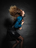 Action shot of an attractive woman swinging her hair. Stock Photo