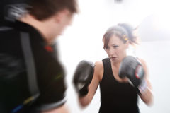 Action shot of girl with personal trainer Stock Photos