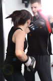 Action shot punching the pads Royalty Free Stock Images