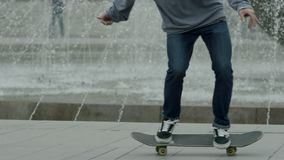 Action shot of a skateboarder skating, doing tricks and jumping in Park. Free riding skateboard. Man made Kickflip at stock video