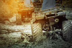 Action shot of sport atv vehicle running in mud track Stock Image