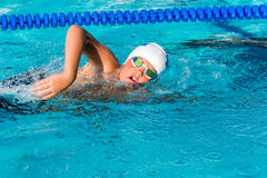 Action shot of teen freestyle swimmer. Close up action shot of teenager practicing freestyle in swimming pool Royalty Free Stock Photos