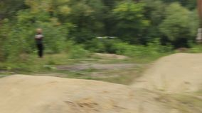 Action shot of two competitors riding BMX bicycle racing against. Stock footage stock video