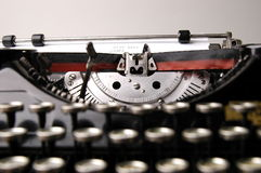 Action shot of typewriter. As letter is typed Royalty Free Stock Photo