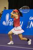 Action shot Zheng Jie at Showdown of Champions Stock Photo