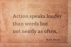 Speaks louder Twain. Action speaks louder than words but not nearly as often - famous American writer Mark Twain quote printed on vintage grunge paper Royalty Free Stock Photography