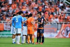 Action In Thai Premier League. BANGKOK,THAILAND-JULY 7:Action in Thai Premier League during the Thai Premier League between TOTSC and Chiangrai United at TOT Royalty Free Stock Photos