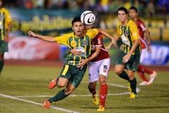 Action In Thai Premier League. BANGKOK,THAILAND-JUNE 30:Action in Thai Premier League during the Thai Premier League between Army United and BEC Terosasana at Royalty Free Stock Photos