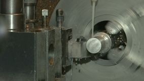 Turning lathe in action, closeup. Action of turning lathe. Piece of metal spinning. Power and precision stock video