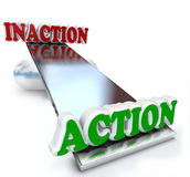 Action Vs Inaction Words on Balance Comparison. The words Action and Inaction compared and weighed against each other on a see-saw balance to illustrate the Royalty Free Stock Image