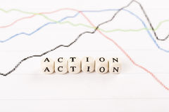 ACTION word written with wooden cubes Stock Images