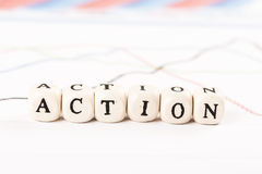 ACTION word written with wooden cubes Stock Photo