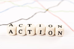 ACTION word written with wooden cubes Royalty Free Stock Image