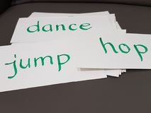 Action words flashcards. On green ink Stock Photos