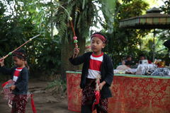 Action by the young orphans of a Cacao, coffee and Spice plantation at the village of Kalibaru in East Java Indonesia Royalty Free Stock Images