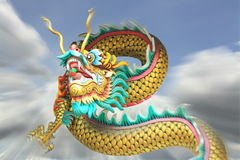 Action zoom blurring china dragon statue flying in the sky. stock photos
