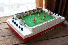 Actionnez le conseil du football de tir et les jeux traditionnels par des jouets de Tomy Image stock