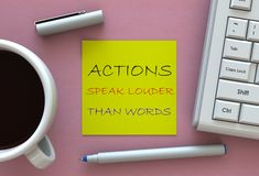 ACTIONS SPEAK LOUDER THAN WORDS, message on note paper, computer and coffee on table. 3D rendering Royalty Free Stock Photography