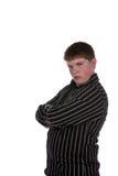 Actitud adolescente con los brazos cruzados y el pendiente Foto de archivo libre de regalías