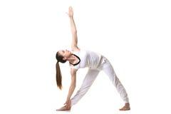 Actitud de Trikonasana de la yoga Foto de archivo libre de regalías