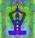 Actitud del loto de la YOGA Padmasana con los puntos coloreados del chakra Foto de archivo