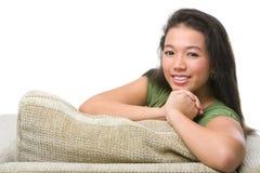 Actitud femenina del adolescente en el sofá Fotos de archivo libres de regalías