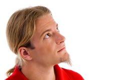 Actitud lateral del varón que mira hacia arriba Imagen de archivo