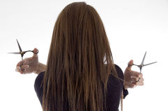 Actitud posterior de la hembra con las tijeras Fotografía de archivo libre de regalías