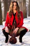 Actitudes de la muchacha con el violín Imagen de archivo