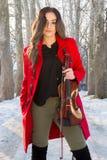 Actitudes de la muchacha con el violín Fotografía de archivo libre de regalías