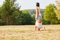 Activ senior man making a headstand Royalty Free Stock Photography
