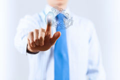 Activate working mechanism. Close up of businessman touching gears mechanism with finger Stock Photo