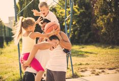 Activate your family. Family playing basketball stock image