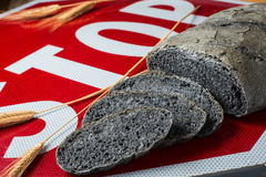 Activated carbon bread stop - pane carbone vegetale. Activated carbon bread - pane carbone vegetale Stock Photo