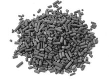 Activated carbon granules. On white background Royalty Free Stock Photos