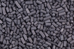 Activated carbon granules close up Royalty Free Stock Photos