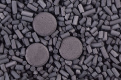 Activated carbon granules and tablets. Background Royalty Free Stock Image