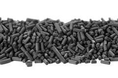 Activated carbon granules. On white background Royalty Free Stock Image