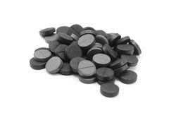 Activated carbon pills. Isolated on white stock photo