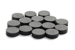 Activated charcoal carbon pills. Closed up Activated charcoal carbon pills royalty free stock photo
