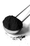 Activated charcoal powder. Shot with a macro lens Royalty Free Stock Photography