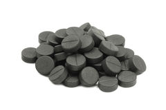 Activated charcoal tablets. On a white background stock images