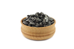 Activated charcoal in a wooden bowl Royalty Free Stock Photography