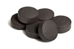 Activated coal. On the isolated background Stock Photos