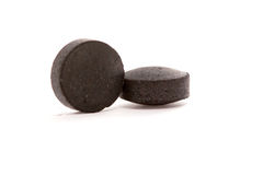 Activated coal tablets isolated on white Stock Image