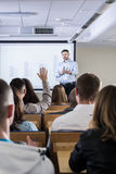 Activating his students during a lecture on economy Royalty Free Stock Image
